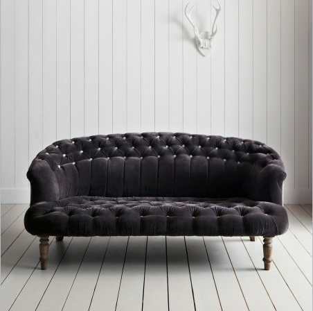 To get the look, pick up the Jester Collection Sofa ($1,717). It's a deeper purple than the lavender tufted sofa in the loft, but we love the moody color.