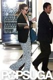 Miranda Kerr had her hands full as she walked through the airport.