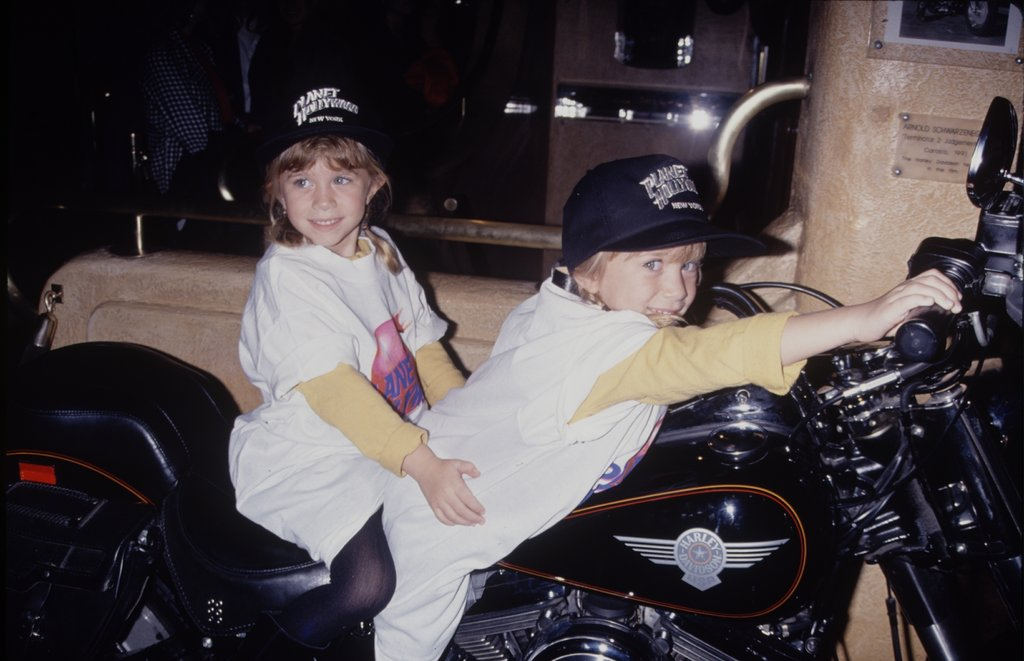 Mary-Kate Olsen and Ashley Olsen had fun playing on a motorcycle together in 1990.