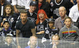 David Beckham and his sons, Romeo, Cruz, and Brooklyn, intently watched the LA Kings Stanley Cup final game in LA.