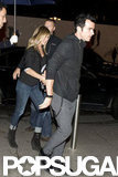 Justin Theroux led the way as he and Jennifer Aniston went into a restaurant in Paris.