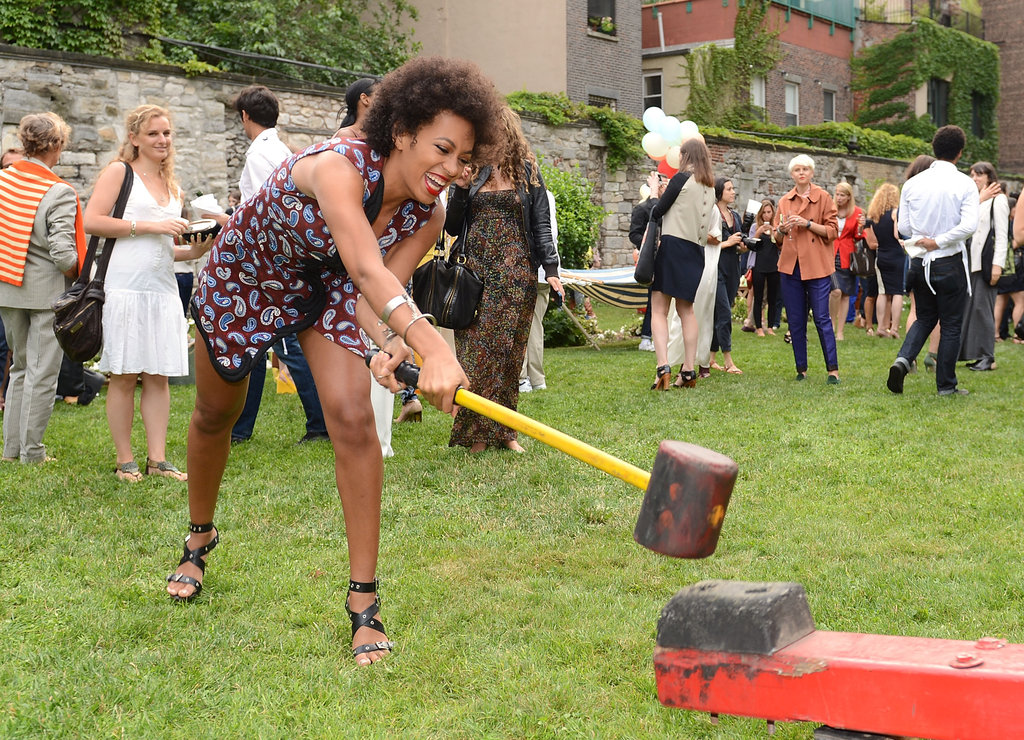 Solange tried her hand at the strongman.