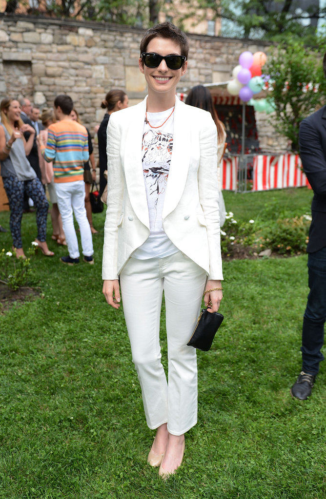 Anne Hathaway showed off the perfect Summer party look in a crisp white suit and shades.