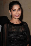 Freida Pinto wore a sheer black dress to the Salvatore Ferragamo Resort collection show in Paris.
