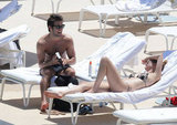 Emily VanCamp and Joshua Bowman lounged poolside in Monaco with a copy of Fifty Shades of Grey in June 2012.