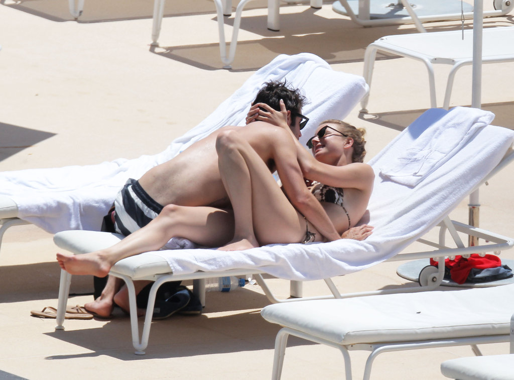Emily VanCamp and Joshua Bowman lounged poolside in Monaco.