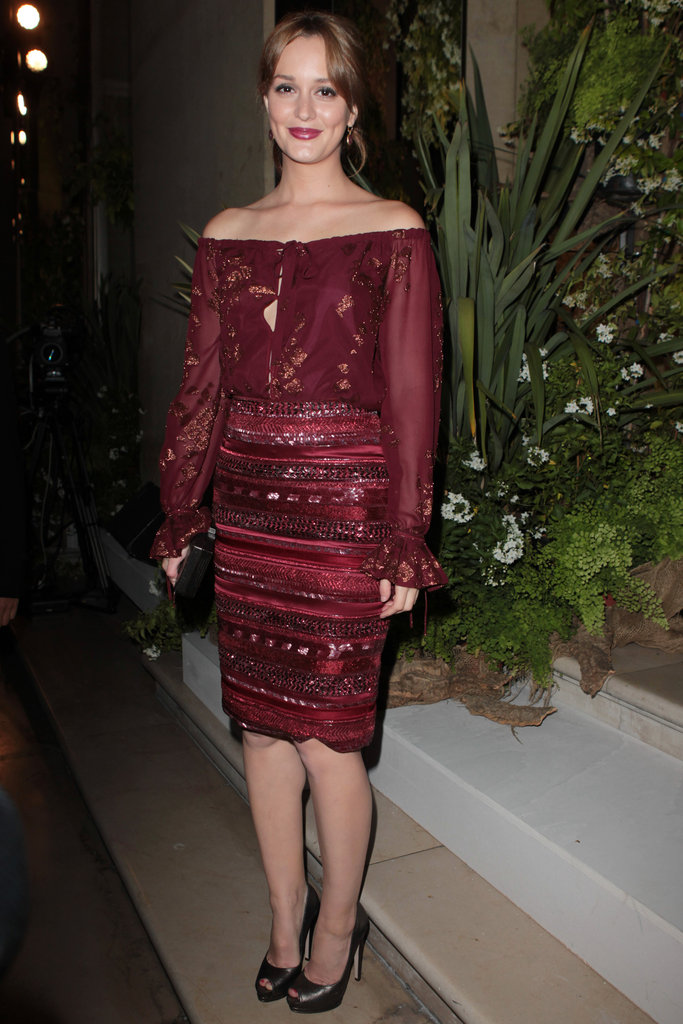 Leighton Meester wore a maroon dress for the Salvatore Ferragamo Resort collection show in Paris.
