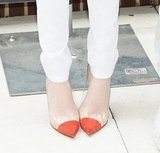 Up close and personal with Emma's bright Christian Louboutin Un Bout pumps at the NYC photocall.