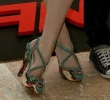 A close-up of Emma's colorful Angela crisscross platform sandals by Brian Atwood.
