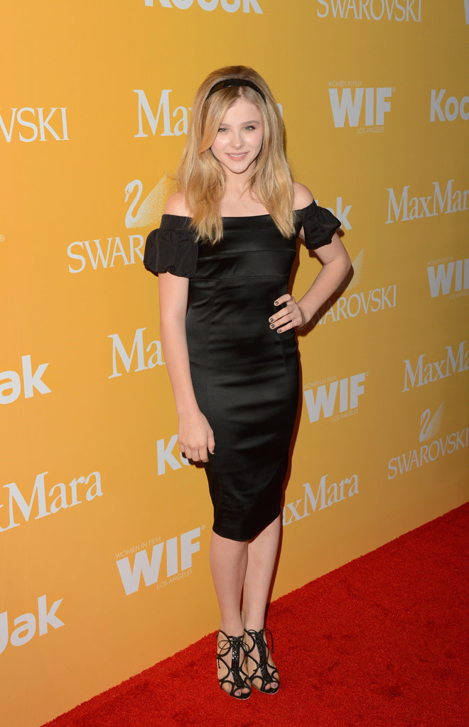 Chloe Moretz showed off her style sense in an off-the-shoulder black cocktail dress and lace-up heels.