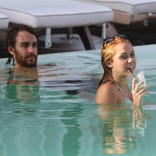 Miley Cyrus in Bikini With Mystery Guy in Miami (Video)