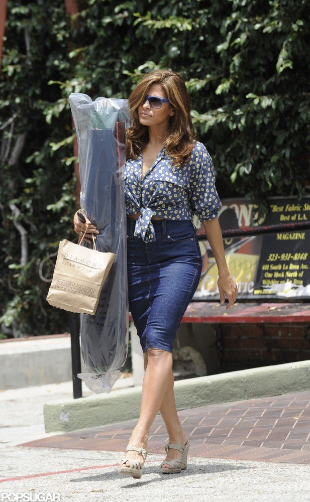Eva Mendes showed off her curves in a fitted denim skirt.