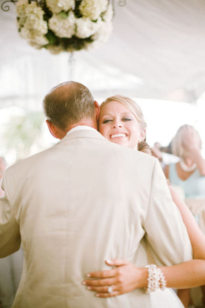 A bride hugged it out with her dad at the wedding. Photo by Scott Piner Photography via Style Me Pretty