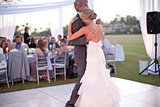 This bride laughed with her father during their dance. Photo by Mishelle Lamarand Photography via Style Me Pretty