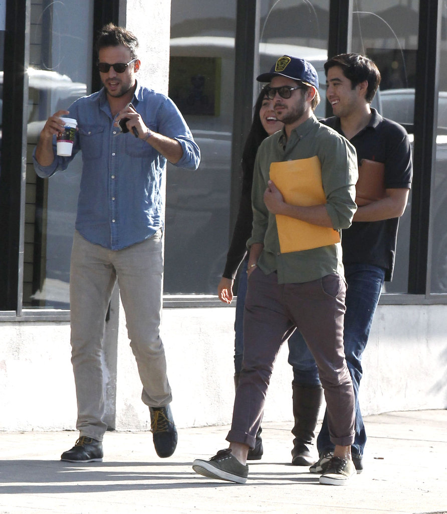 Zac Efron walked with a script under his arm after getting out of a meeting in LA.