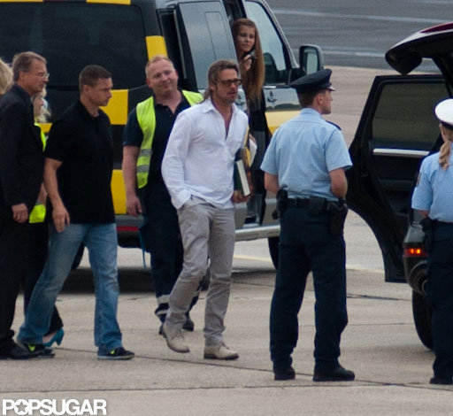 Brad Pitt walked through the airport tarmac.