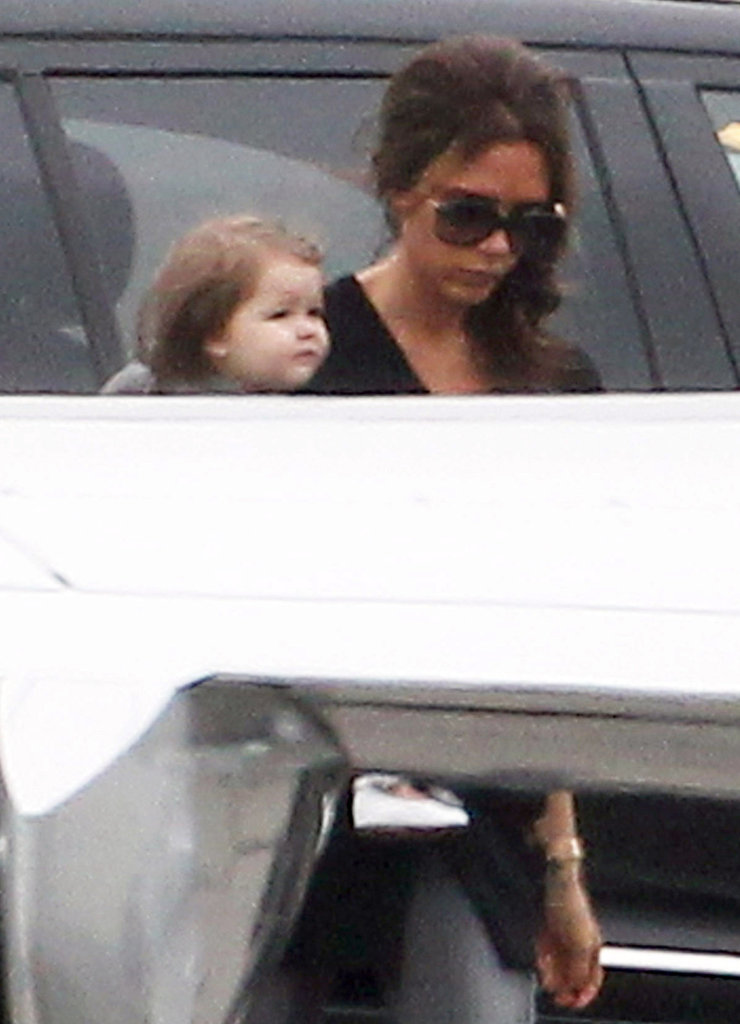 Victoria Beckham had Harper Beckham in her arms as she headed for a private jet.