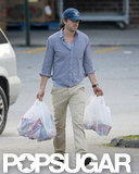 Ryan Reynolds had grocery bags in his hands as he walked to the car in New York.