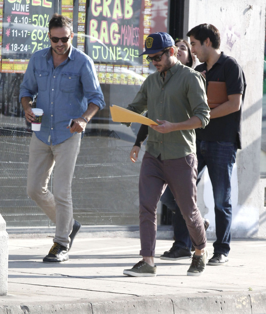 Zac Efron looked at a script after leaving a meeting in LA.