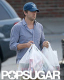 Ryan Reynolds carried grocery bags to his car in New York.