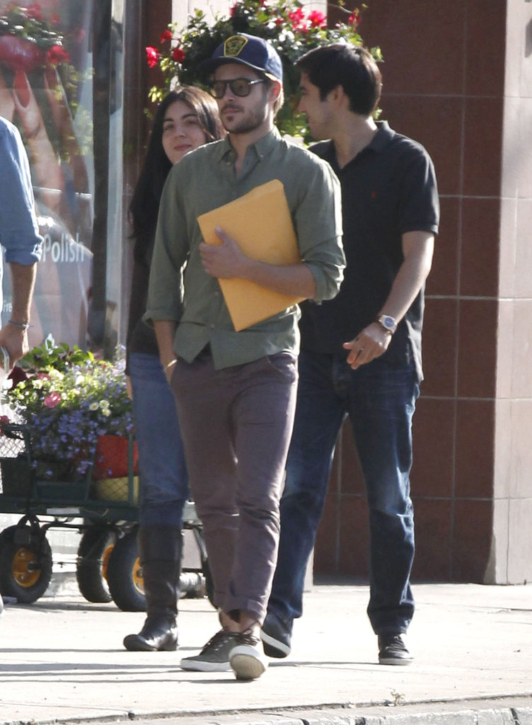 Zac Efron carried a script in his arms in LA.