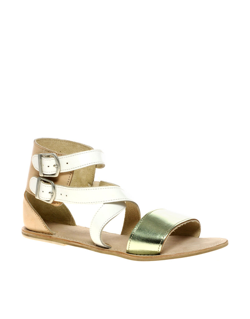 Just a flash of metallic elevates this pair of everyday flats to event status with the right maxi dress.  Asos Flat Leather Sandals with Colorblock Cross Straps ($42)