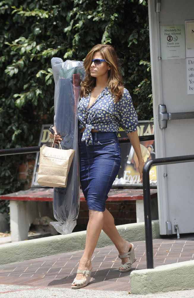 Eva Mendes showed off bombshell curves even while running errands, in a fitted denim pencil skirt and a knotted button-up.