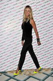 All black and neon Christian Louboutins on The Body? A-m-a-z-i-n-g. Elle Macpherson wore a black, one-sleeve Louis Heal ensemble for the launch of Britain & Ireland's Next Top Model and we think she should be auditioning to be on the show, instead of hosting it!