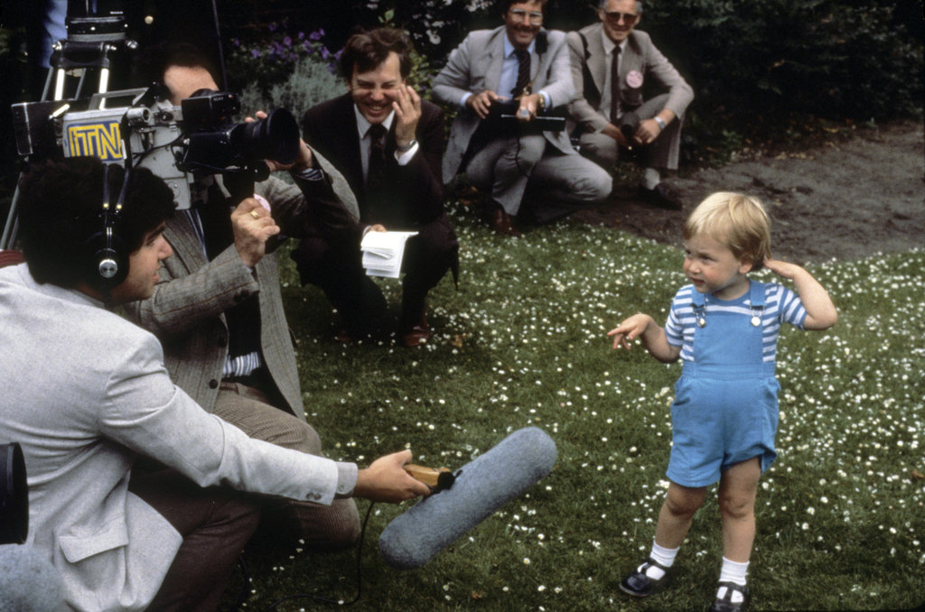 Prince William showed skill with the press as a toddler at Kensington Palace in June 1984.
