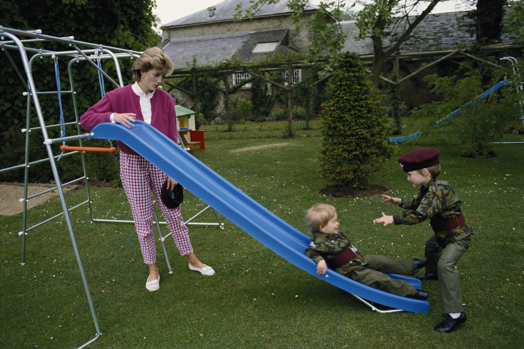 Prince William and Prince Harry played in uniforms in the garden of Highgrove House in Gloucestershire, England, during July 1986 with their mum, Princess Diana.