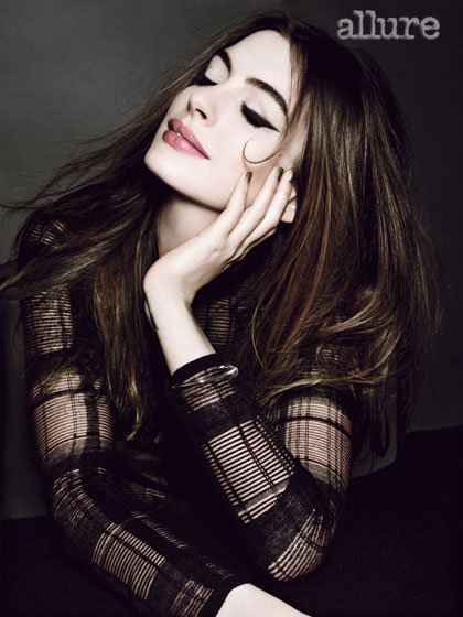 Anne Hathaway looked sexy in a sheer black shirt for Allure's July issue.