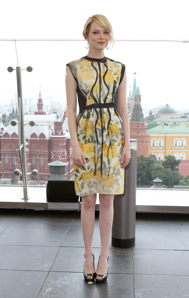 We're loving this yellow painted Lanvin sheath she wore to the Moscow photocall. To edge it up, she added stacked rings and Brian Atwood peep-toe pumps.