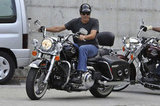 George Clooney rode his motorcycle in Milan.