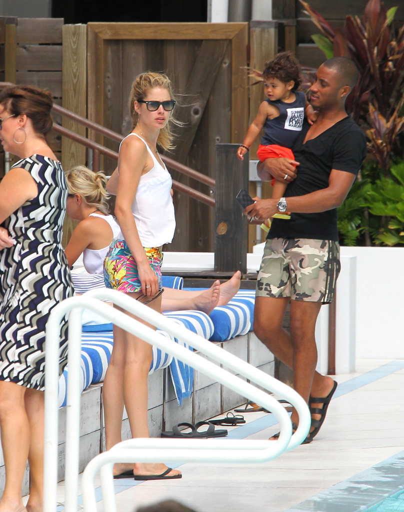 Doutzen Kroes covered up before leaving the pool.