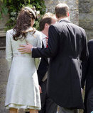 Prince William rested his hand on Kate Middleton's back at a wedding in June of 2012.