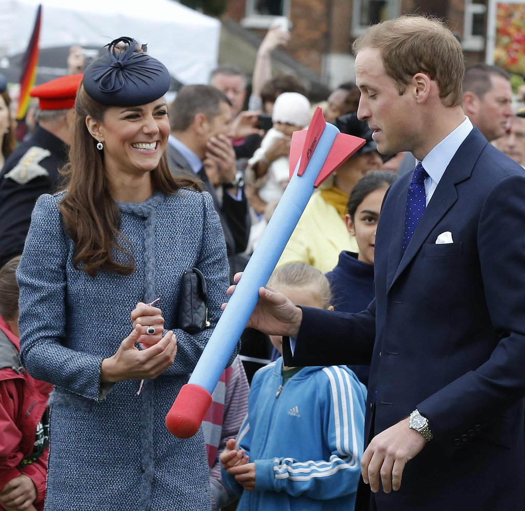 Kate Middleton and Prince William laughed while preparing to throw a foam toy during an event in June, 2012.