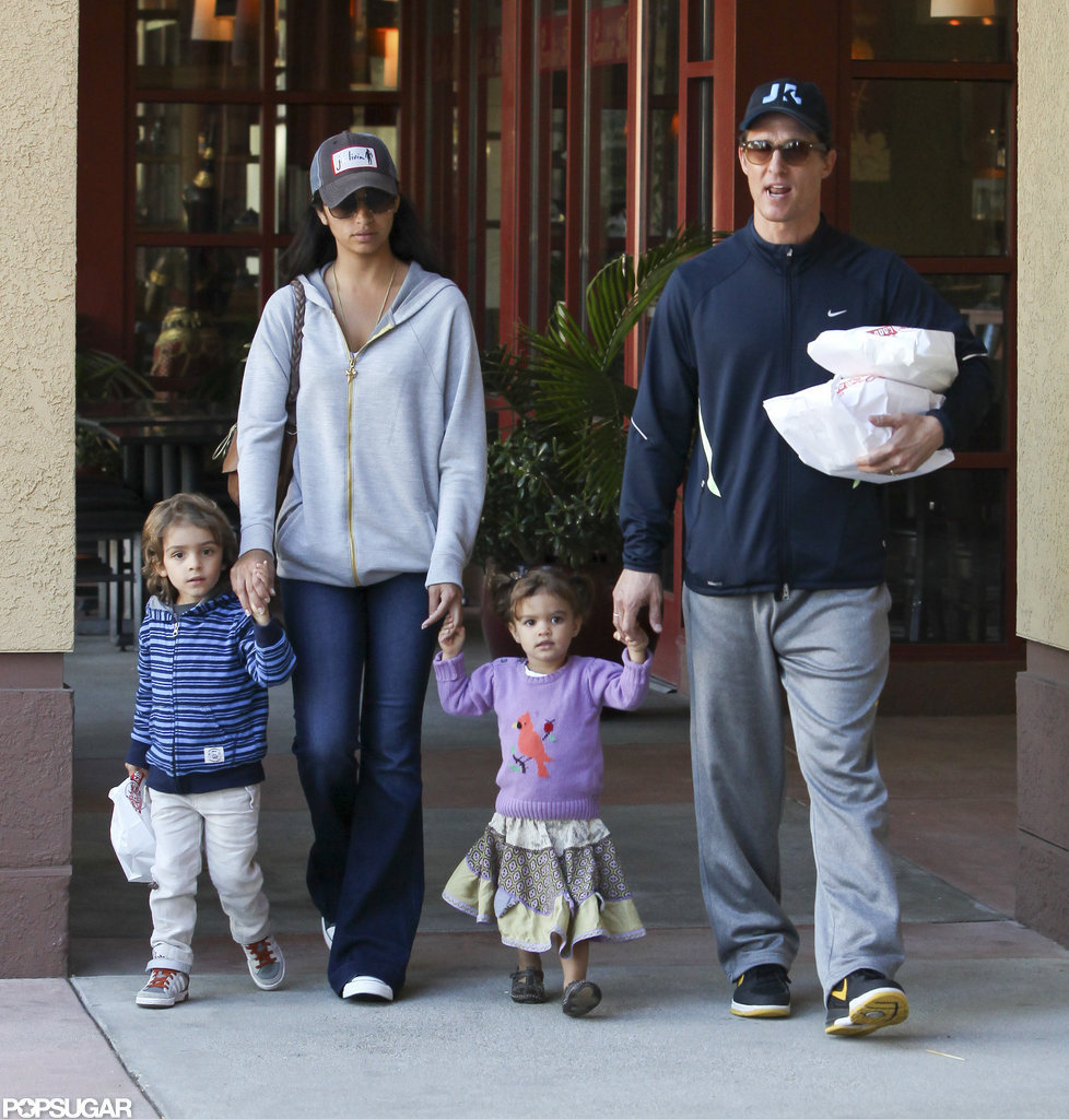 Matthew McConaughey, Camila McConaughey, Levi McConaughey, and Vida McConaughey held hands.