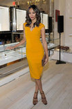 How gorgeous does she look in this yellow jewel-toned Michael Kors sheath at the designer's LA boutique opening in November 2011?