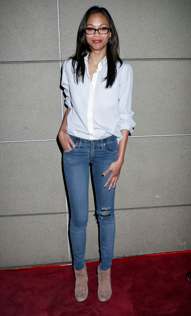 Just as easily as she can glam it up, she can keep it sleek and casual, too. Her white blouse, nude booties, and skinny jeans prove classic and cool.