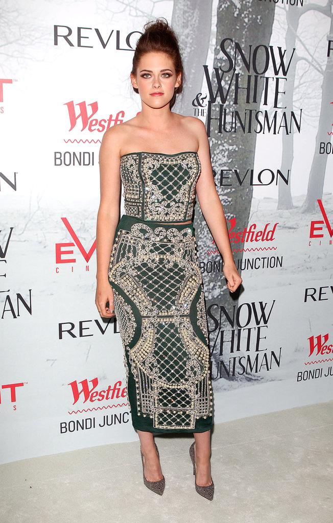 Kristen Stewart looked breathtaking in an embroidered green Balmain two-piece ensemble and gold Christian Louboutin pumps at the Snow White and the Huntsman Sydney premiere.