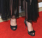 Christina Hendricks perfected her ladylike-cum-sexy look right down to her toes with lacy heels adorned with a bow.