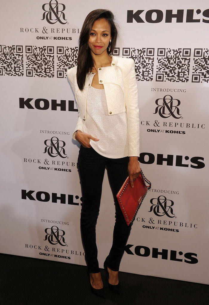 She accented her slick black-and-white ensemble with a fiery red envelope clutch at Rock & Republic For Kohl's fashion show in February 2012.