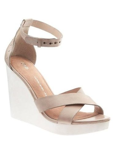 A neutral, comfy wedge that will go with anything.  Gap Wedge Sandal ($70)