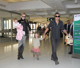 Nicole and Keith held Sunday Rose's hands through Sydney Airport.