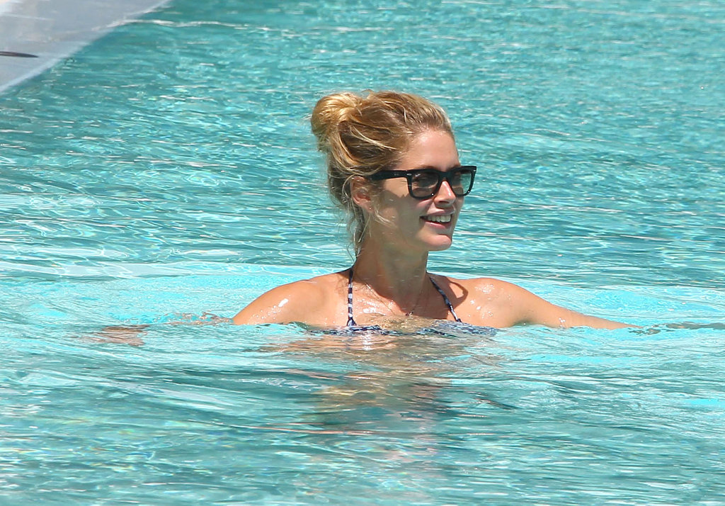 Doutzen Kroes relaxed in the pool while vacationing in Miami with her family.
