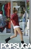 Miley Cyrus showed off her figure in short shorts as she headed into an American Apparel store in LA.