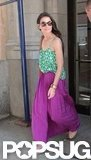 Katie Holmes left her NYC apartment wearing a purple maxi skirt and printed green tank.