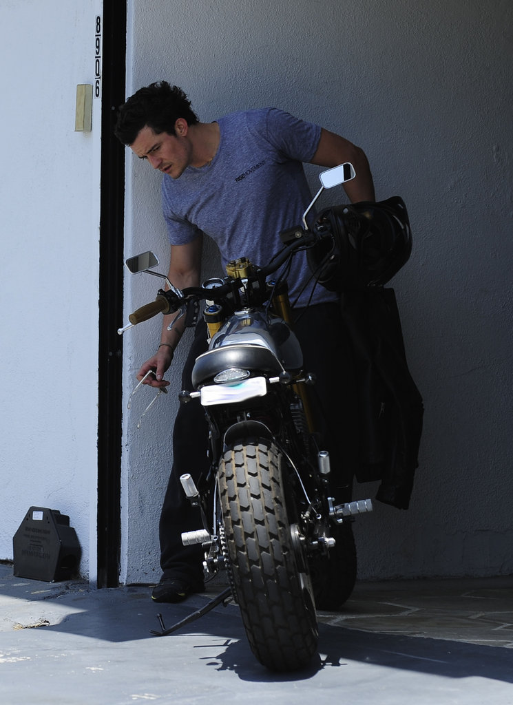 Orlando Bloom checked out his bike after a workout in West Hollywood.