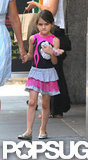 Suri Cruise carried a baby-doll out of Whole Foods in NYC.