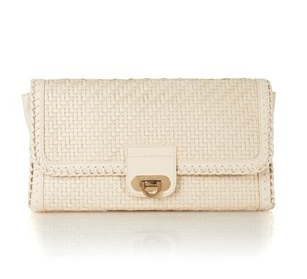 You can carry this chic woven clutch to carry to all your Summer weddings, cocktail parties, and more.  French Connection Betty Braid Clutch ($49, originally $98)